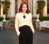 Priscilla Presley in front of Graceland