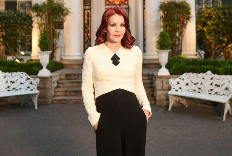 Priscilla Presley in front of Graceland